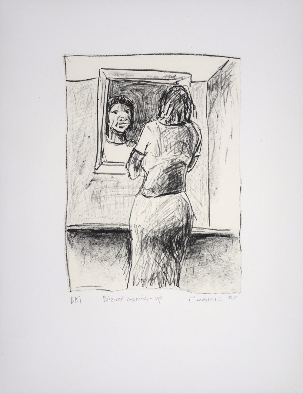 Woman seen from the back looking at her face in a mirror