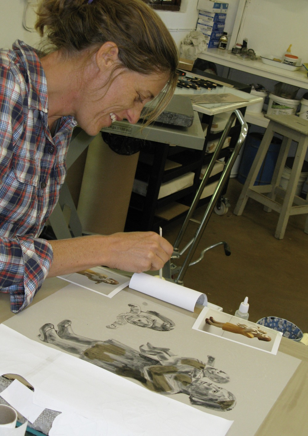 Claudette Schreuders painting onto a lithographic stone for her print titled