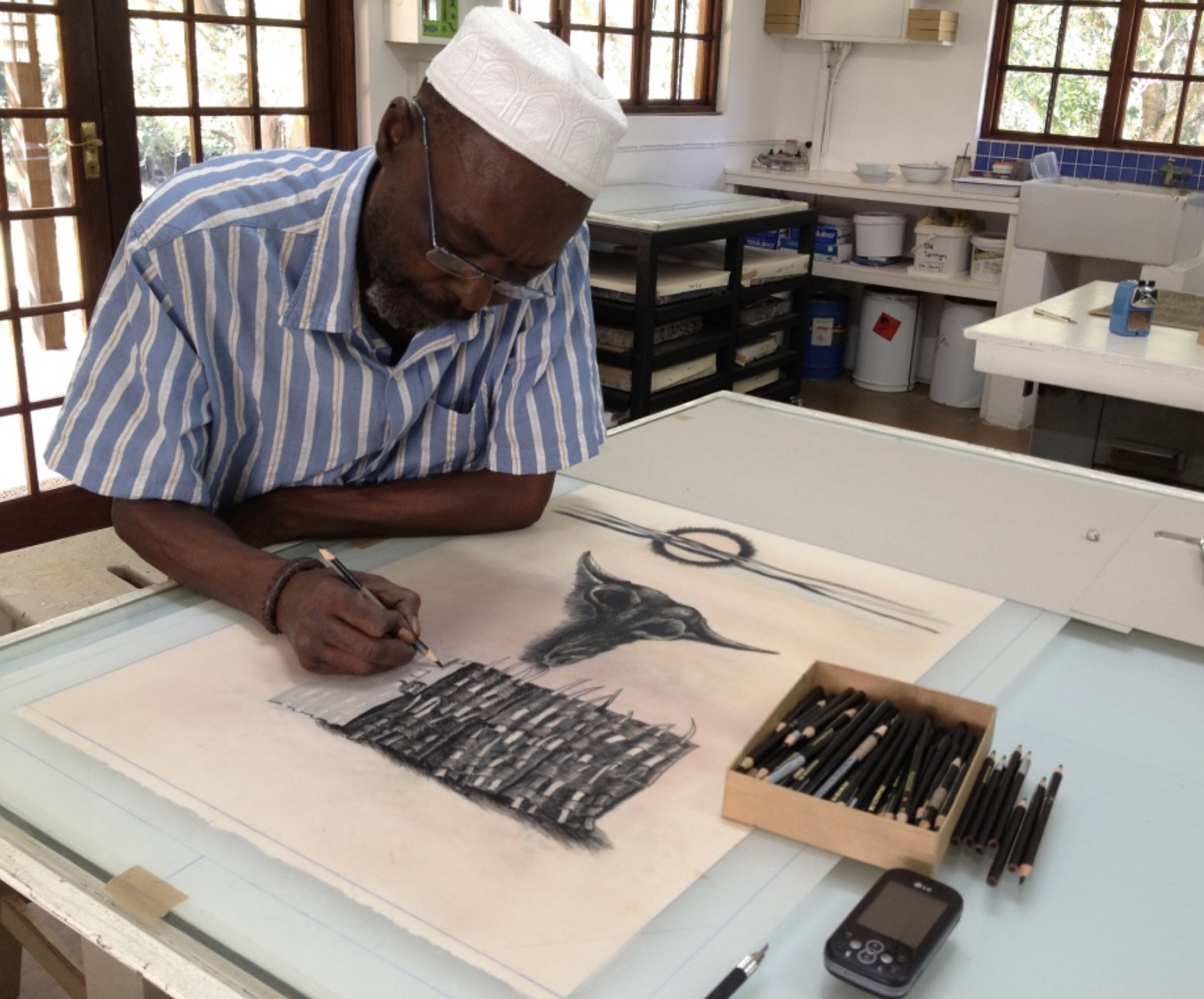 Dumisani Mabaso drawing onto grained film with litho crayon for a lithograph of his.