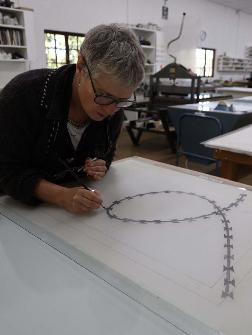 Erika Hibbert at The Artists' Press working on a monoprint of hers