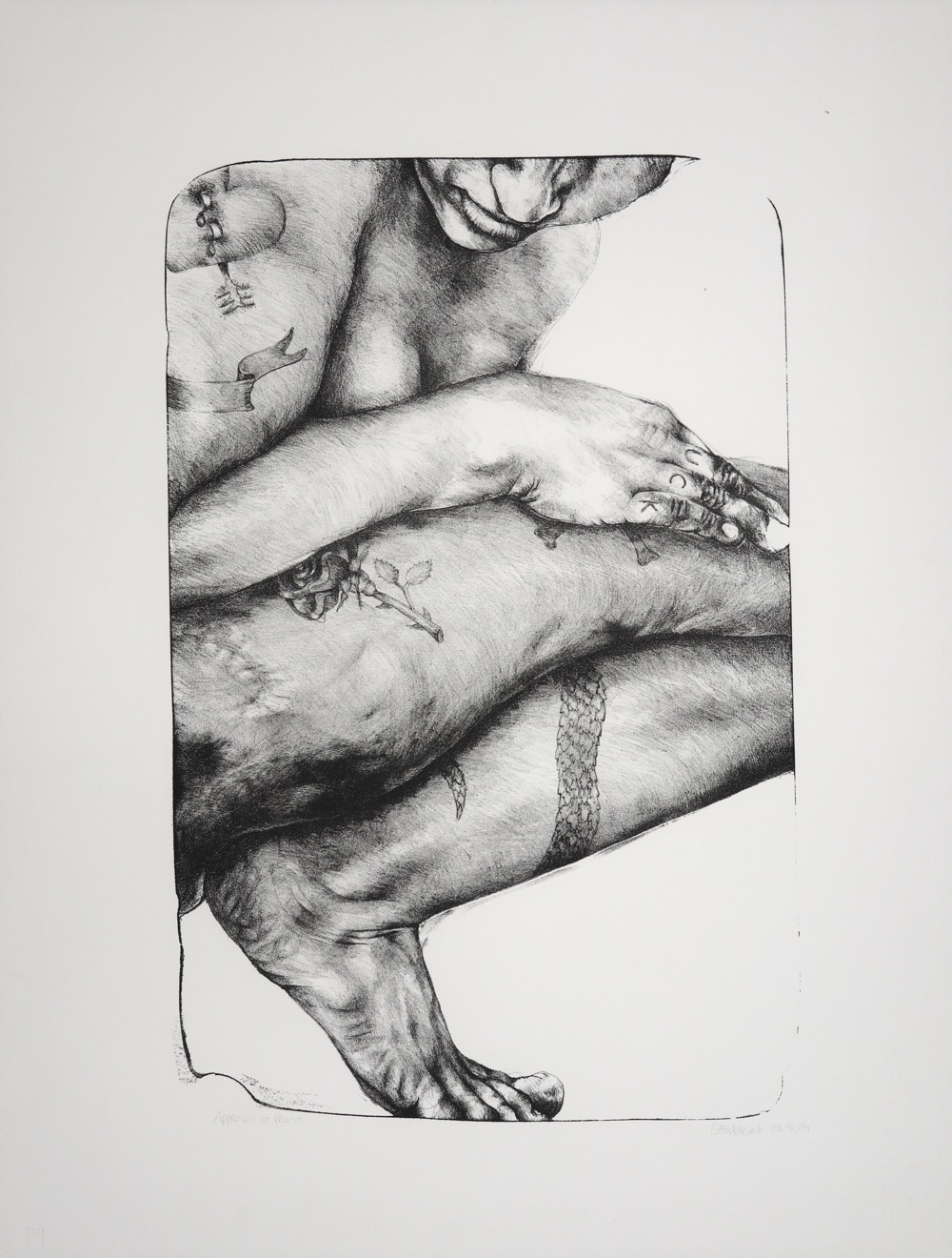 Close up side view of woman crouching with tatoos on limbs and  fingers