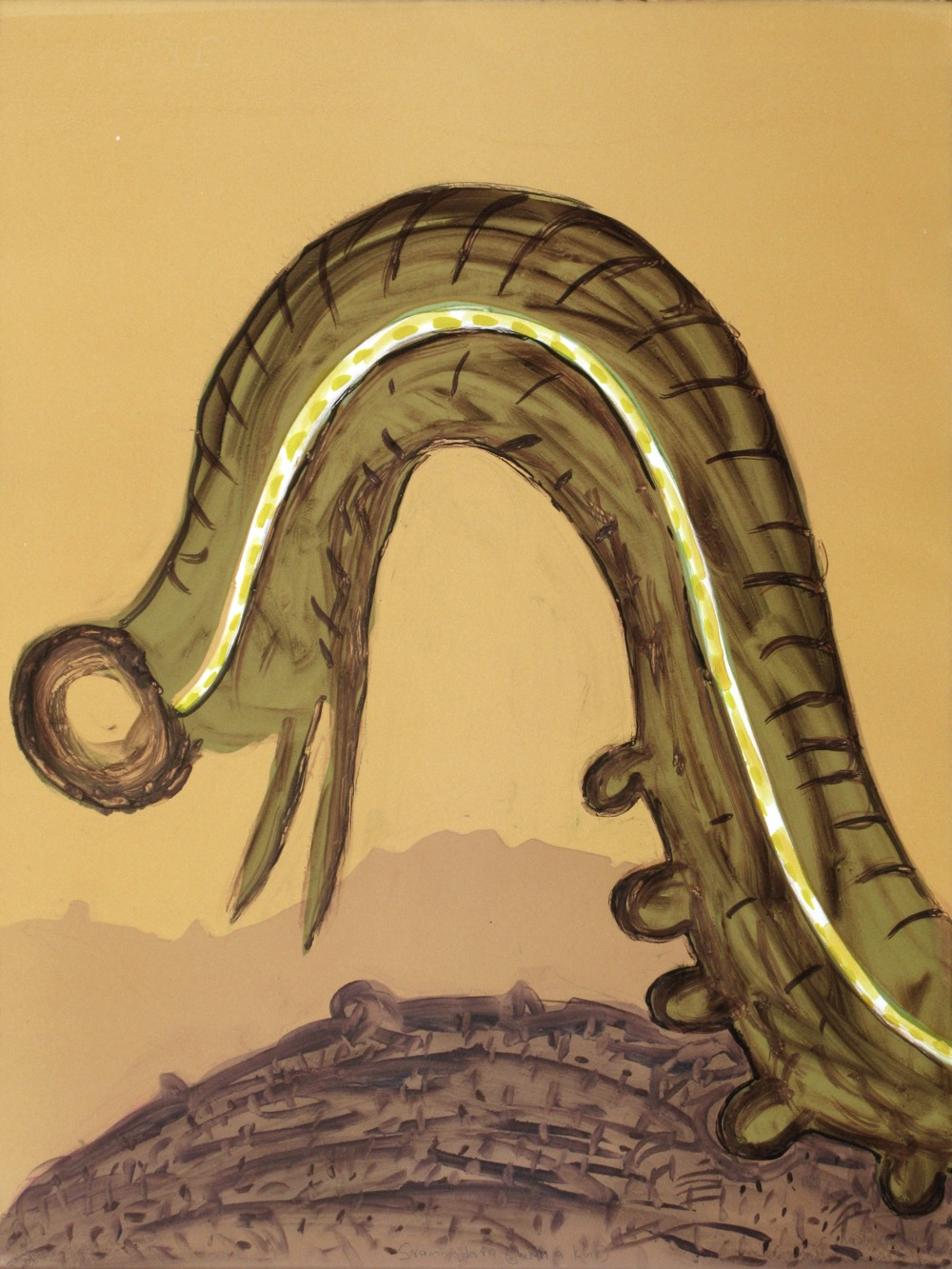 A large caterpillar moving into the image frame with a vast landscape behind it.