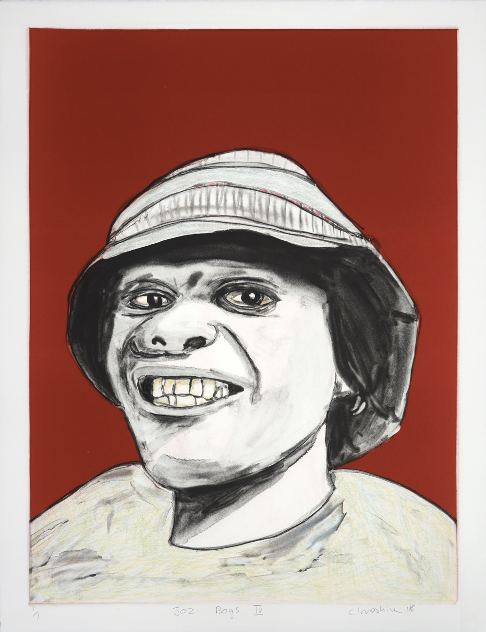 Smiling young man in bucket hat looking directly at the viewer.