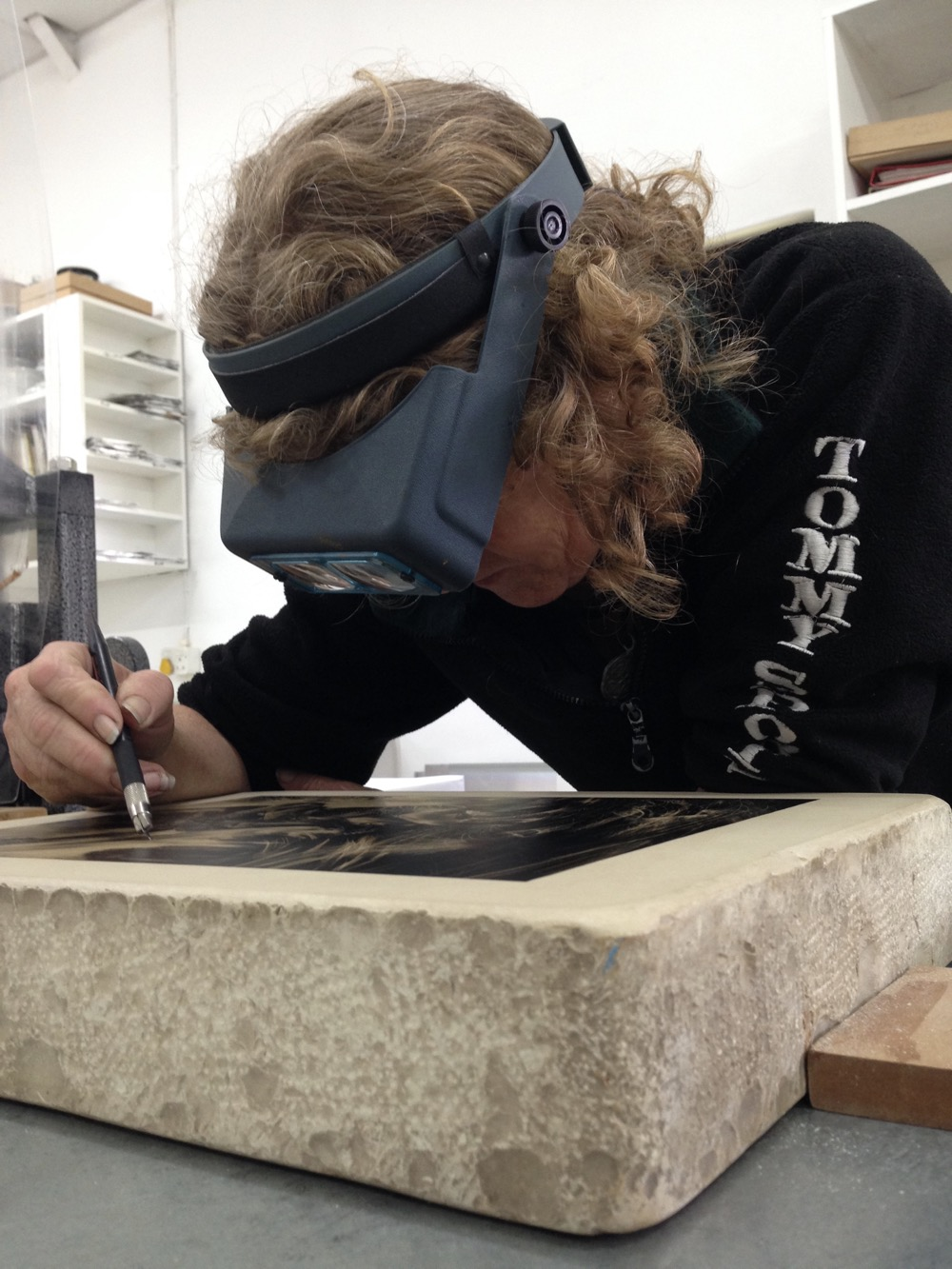 Photograph of Diane Victor working on a litho stone at The Artists' Press